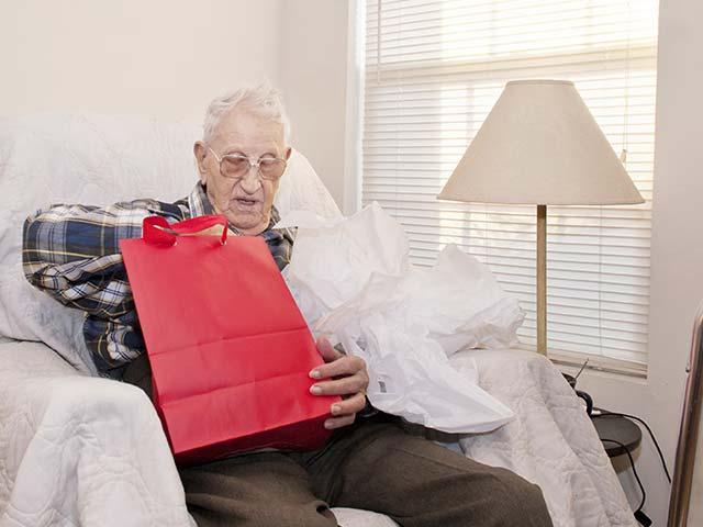 man-opening-gifts